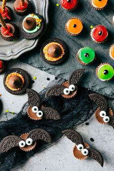 Break an Oreo cookie in half to use as wings on a Reese's butter cup. Add candy eyes and you have yourself some edible bat bites.