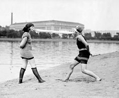 two girls in bathing suits playing with a towel | june 1922 | #vintage #1920s #fashion