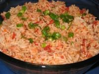Easy to make rice like you get at the mexican restaurant. Cooks up in your rice cooker without any fuss, mess or stirring! Haven't tried it- but could be made on the stovetop in. Fiesta Rice Recipe, Mexican Rice Recipes, Mexican Dishes, Food Dishes, Main Dishes, Side Dishes, New Recipes, Favorite Recipes, Recipies