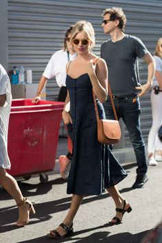11 September Sienna Miller looked chic at the US Open in a navy button-down…