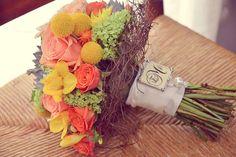 Orange, yellow & silver. Flowers of billy balls, succulents, garden roses, hydrangea, viburnum fressia, dahlias & ranunculus. www.brettestart.com