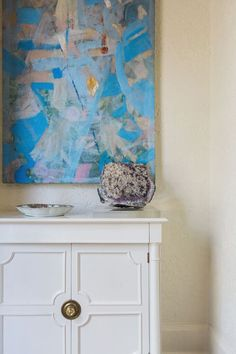 white wooden chest with gold accents | blue abstract artwork | blue print | blueprintstore.com