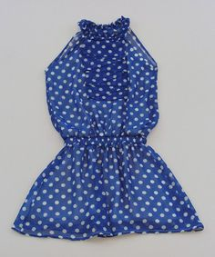 From the Champs Elysees to Montmarte, petite Parisians will adore the easy fit of this sweetly stylish frock. A ruffle-rich bodice and polka dot print top off this ensemble for a look that's ooh-la-la lovely.