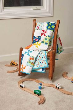 Kid and baby quilt patterns are always a hit! And, why not? They tend to be absolutely adorable, like the Apple Farm quilt by Bev Getschel. What a way to show off some favorite precut prints! This quilt works as a twin-size quilt, too.