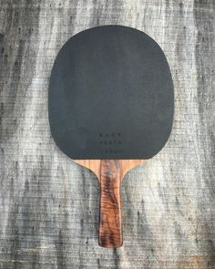 Black Leather Tapered Walnut Ping Pong Paddle  http://www.backfortywoods.com/table-tennis/dcglkow5djzjlakkvh41mcbjsq4283