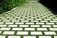 a driveway made of pavers with grass joints