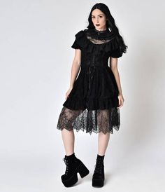 Black is a necessary ingredient to beauty, dears! A regal Victorian inspired dress in a fabulous array of black velvet and lace, this stunning frock exudes vintage verve in spades. The frilly high collar is tiered in multiple layers of fabulous fabrics wh