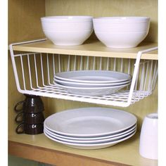 Organize your kitchen and maximize your storage space with this under the shelf storage basket. The wire mesh basket is ideal for storing extra towels, dishes, and sandwich bags. The heavy duty shelf