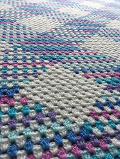 http://www.ravelry.com/projects/cuddlycritter/granny-stitch-planned-pooling-blanket