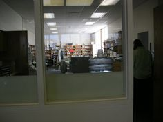 The workroom is shared by several staff members.  It has a glass front so the public can see this area.  The Director's office opens off the workroom.