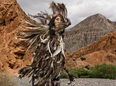 In Argentina's Jujuy Province, the Suris, also known as Samilantes, are a cultural group within the Quechua community. This woman is Belén Cruz. Her feathered costume represents the nandu, or rhea, sacred bird of the Suris. Photographer Marco Vernaschi's Biophilia Foundation looks to help indigenous groups preserve their cultural heritage by developing their own local economy through native products.  Vernaschi's pictures are featured in the April 2015 issue of National Geographic magazine…