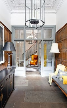 Period charm: the dramatic restoration of a Georgian townhouse in Edinburgh The glazed inner door in the entrance hall has been painted grey to offset the rich tones of the wooden panelling entrance hall ideas House Design, House, Interior, Home, Townhouse Interior, Georgian Interiors, House Interior, Coastal Living Rooms, Wooden Panelling