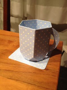 Teacup with envelope punch board