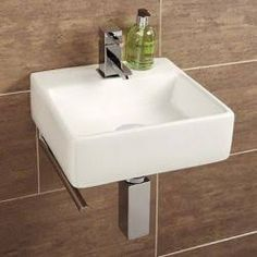 small cloakroom basin with towel rail - Google Search