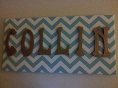 Chevron print fabric covering a canvas board with painted wooden letters hotglued on. #chevron #diy