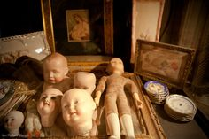 #Sofa cases filled with previously owned #dolls and #porcelain #plates
