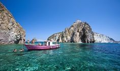 A boat anchored near to Palmarola island, Ponza Island, Pontine Islands, Lazio, Italy