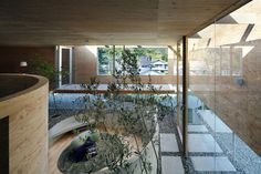Entering house  through a garden from below Pit House / UID Architects