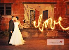 Bride and groom with sparklers used for light painting. Sutherland Hill Farms Photography: photo by Wallace Krebs