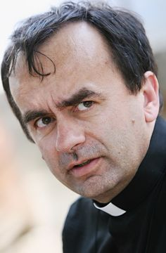 """Father Patrick Desbois is a Roman Catholic priest and head of the Commission for Relations with Judaism of the French Bishops' Conference. He has spent years searching for unmarked common graves in Ukraine, where over one million Jews were shot by the Nazis. His awards include the Medal of Valor by the Simon Wiesenthal Center, the Humanitarian Award by the U.S. Holocaust Memorial Museum, and the Jan Karski Award by the American Jewish Committee. He authored """"Holocaust by Bullets"""" in 2008."""