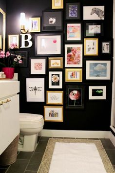 This bathroom went from bland to striking when the homeowners traded beige walls for this moody tone. A gallery wall adds color and fun to an often traditionally styled space.  See more at The Vault Files »