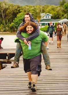 Jorge Garcia giving Matthew Fox a piggy back ride on the set of Lost. I do believe this is season 3, maybe? Based on Hurley's shirt, and the dock and green house in the back.