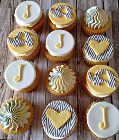 """Baby shower cupcakes with chevron elephants, hearts and """"j""""'s in yellow, white and grey 