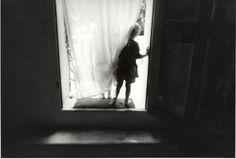 Boys in doorway, Fontvieille 1989 by Eva Rubinstein