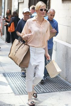 Fun touch: Cate wore black and white polka dot sandals and carried a gold striped gift bag...