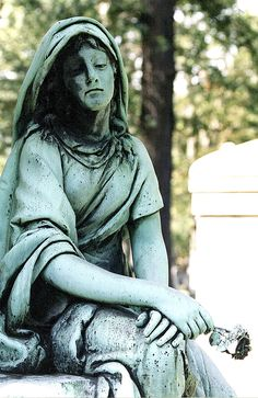 """Woodlawn Cemetery, founded in 1896, is located north of Detroit's prestigious Palmer Woods neighborhood. This bronze statue is one of the beautiful memorials and mausoleums located here. The site is the W.H. Harrison Memorial, though I have named her the """"Bronze Memorial."""" This photograph made it to Explore. Thanks to all who viewed and/or commented on it."""