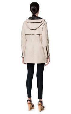 HOODED PARKA WITH GUSSETED POCKETS