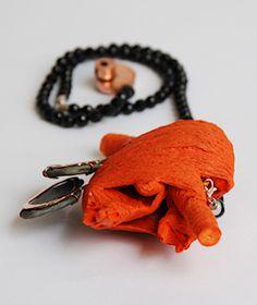 Gular Mustafa-Brooch: Heart, 2009. Wood, cotton, copper, glass stoon, pigment