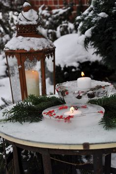 pretty lantern and ice votives in the snow