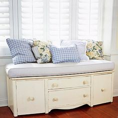 Cut the legs off an old dresser and turn it into a bench with storage.  Add pillows! Great idea!