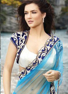 Beautiful Designer Net Saree in Firozi with velvet blouse