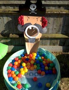 Pirate Ball Toss Game. Click on link for tutorial. http://www.freekidscrafts.com/pirate-ball-toss-game/