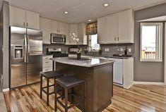 Contemporary Kitchen with Undermount sink, partial backsplash, built-in microwave, Casement, Paint 1, Simple Granite, Paint 2