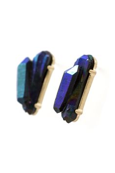 New today! These mesmerizing studs are a great match for a dramatic look. Pair them with navy or black to show off their iridescent green and blue color. $21