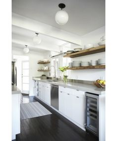 I kind of like how clean and simple it is without the upper cabinets. The butcher block shelves make a nice statement.