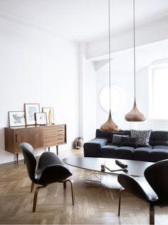 White living w/ black seating/furniture & wooden cabinet/ flooring