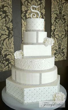 Stunning white, diamonte and silver wedding cake.  Perfect and yummy!