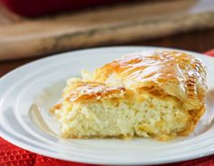 Greek Savory Cheese Pie - a traditional and very popular European treat. A cheese pie filling made with bechamel sauce, feta cheese, ricotta between 2 layers of puff pastry. Greek Cheese Pie, Cheese Pies, Cake Ingredients, Homemade Taco Seasoning, Homemade Tacos, Greek Recipes, Pie Recipes, Recipies, Gastronomia