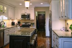 Let us build your dream kitchen! Give us a call at 704-434-0823 or visit our website http://walkerwoodworking.com/#WalkerWoodworking #Custom #CustomCabinets #Kitchen #KitchenDesign #GlassDoors #SaddleStools #PaintedCabinets #Island #KitchenLighting
