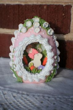 Consider our sugar eggs for your Easter decorations this year. This darling upright pink sugar Easter egg is decorated with lily of the valley and a cute bunny inside.  This small sugar egg is perfect for any Easter basket. Order yours today!