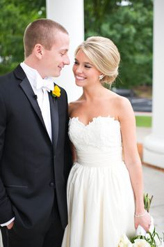 I love everything about this. Her dress, her hair, her natural make-up, and her groom's look