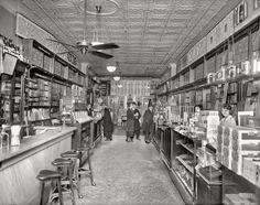"Washington circa 1920. ""People's Drug Store, interior, 11th & G streets."" In the Rubber Goods section in back you'll find the inevitable ""trusses and abdominal belts."""