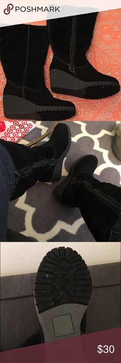 All man made material black wedge boots Faux suede black tall, wide calf & width boots. Just sitting in my closet, forgotten😀 I used the lint roller on them, and they look great. I have wide calfs, and I can tuck jeans and zip with no problem. Size 9 & 1/2W Shoes Winter & Rain Boots