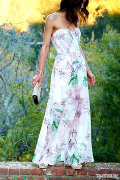 We're loving these sheer layers and oversized florals! Part maxi, part cocktail dress, this style works for any summer party — just add wedges and statement earrings.