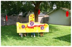 beatles birthday party! yellow submarine with face cut-outs.