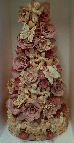 Roses Cherubs Butterflies Intricate Cake.baked in Brighton by the Choccywoccydoodah team!